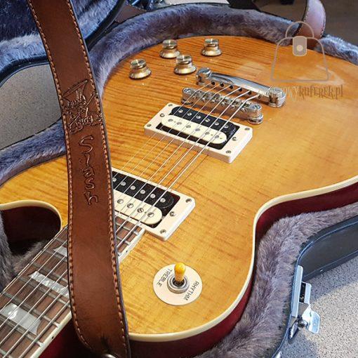 Skórzany pasek do gitary logo