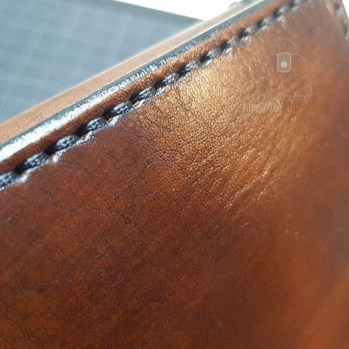 Skórzany portfel tłoczenie szew